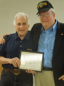 Photo of John Carpenter, a.k.a. The Movie Man, receiving an Appreciation Award from Richie Ornstein of the New York Veteran Police Association