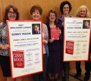 Reader Services Department holding Ginny Moon posters.